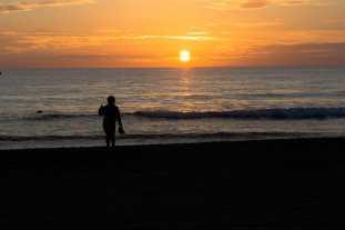 Lone girl admiring sunset