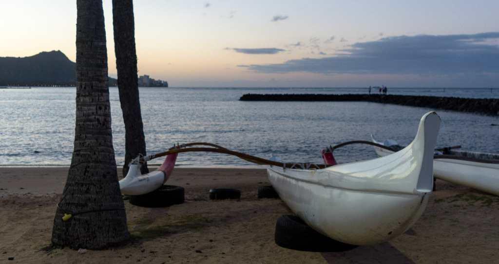 Outrigger canoe along the shore of Kahanamoku Beach in Waikiki