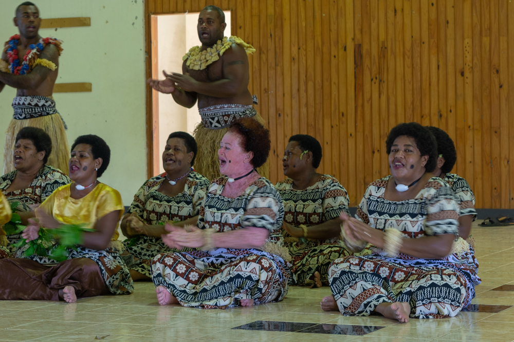 Members of the local tribe singing for us