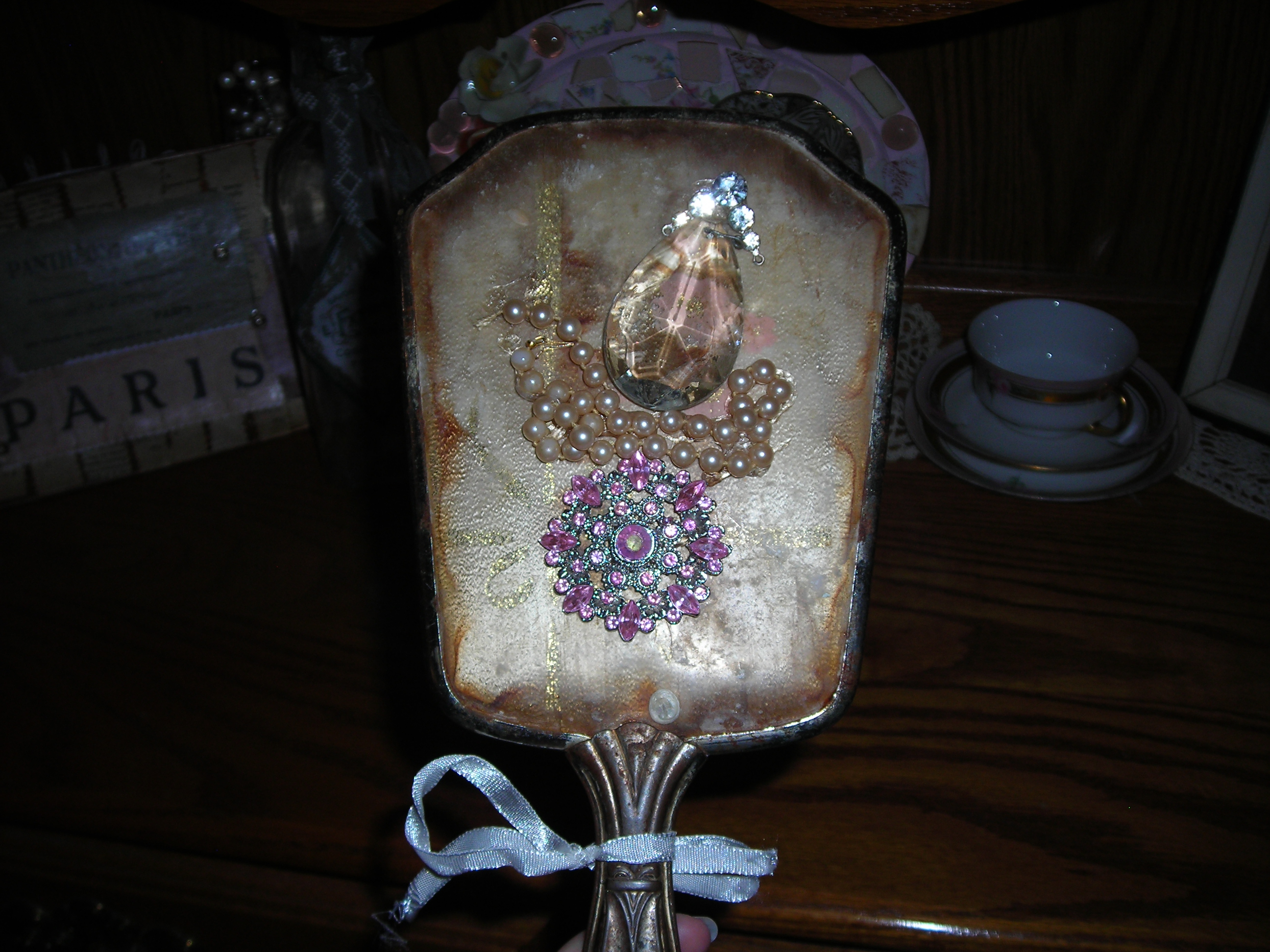 Old hand mirror, blinged up. Sue's the best!