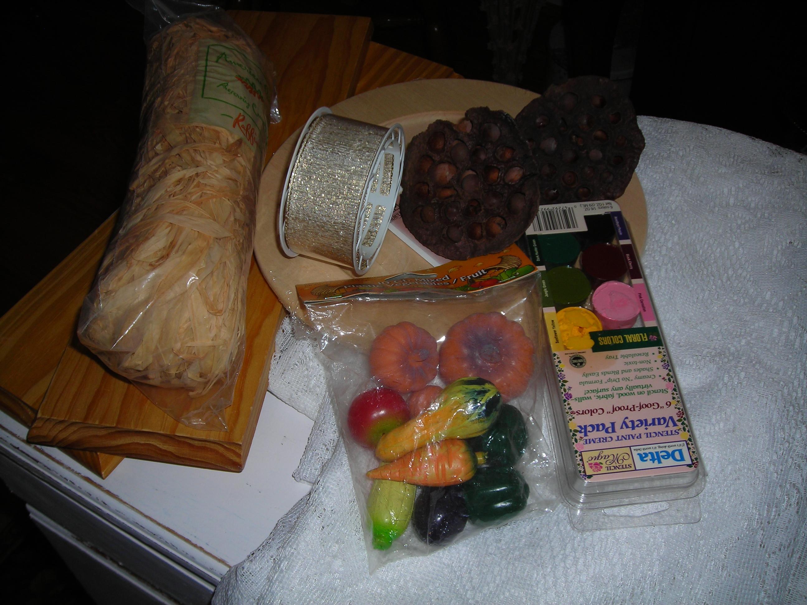 Crafting supplies ... 2 boards, fall veggies, paint, ribbon, etc.