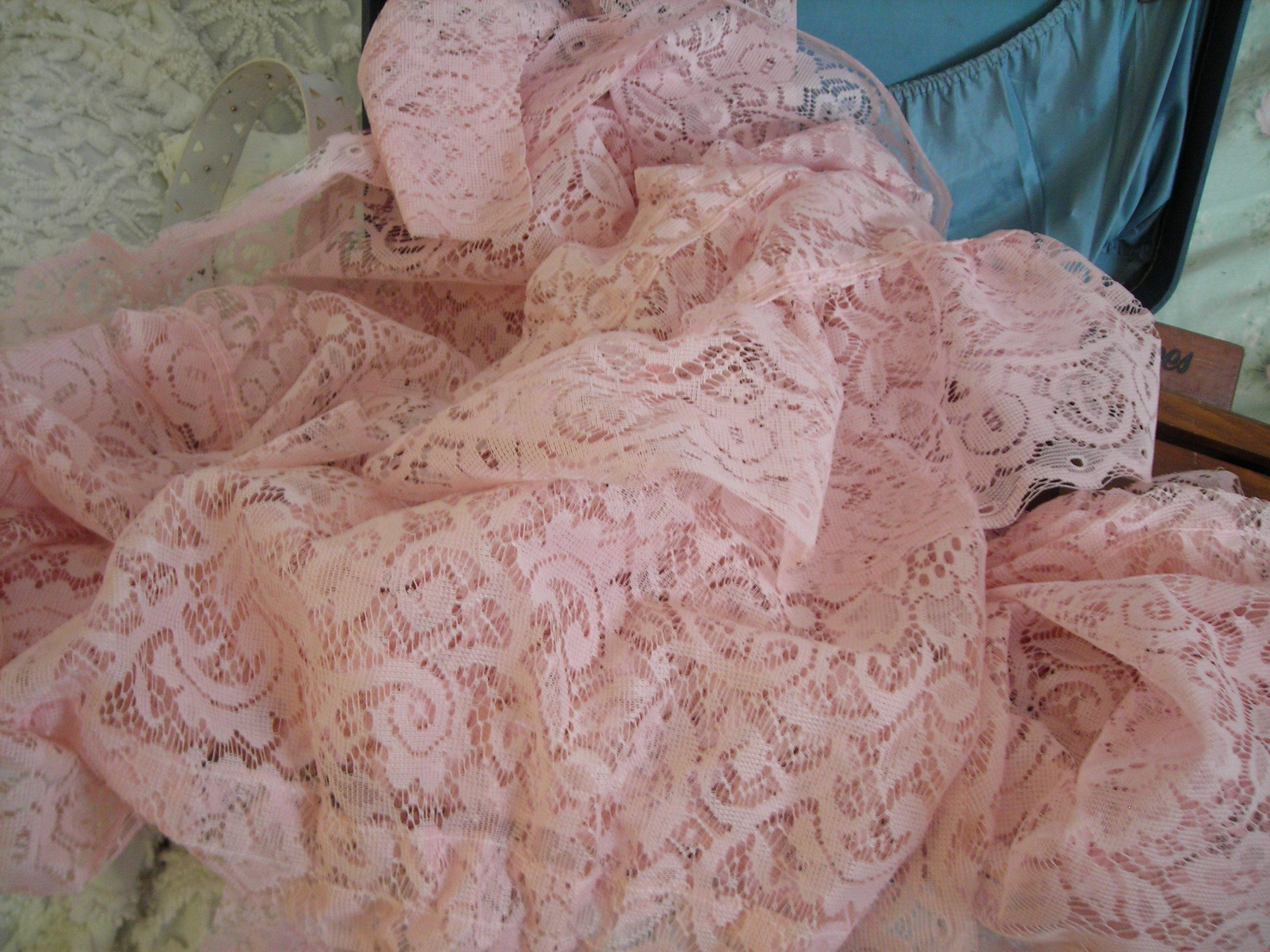 lotsa, lotsa pink lacy curtain panels and valances