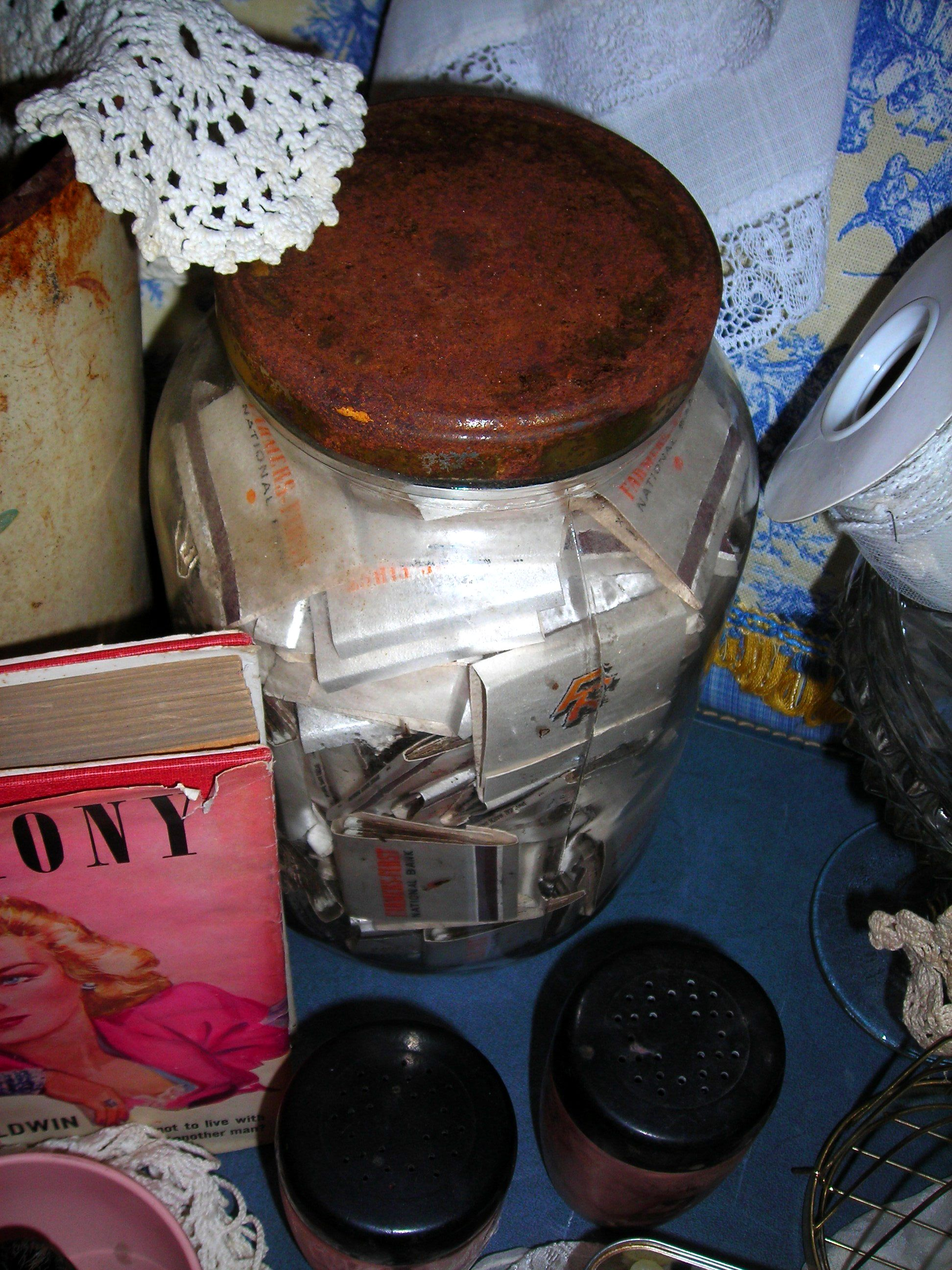 cool, cool old rusty-lidded huge jar filled with matchbooks