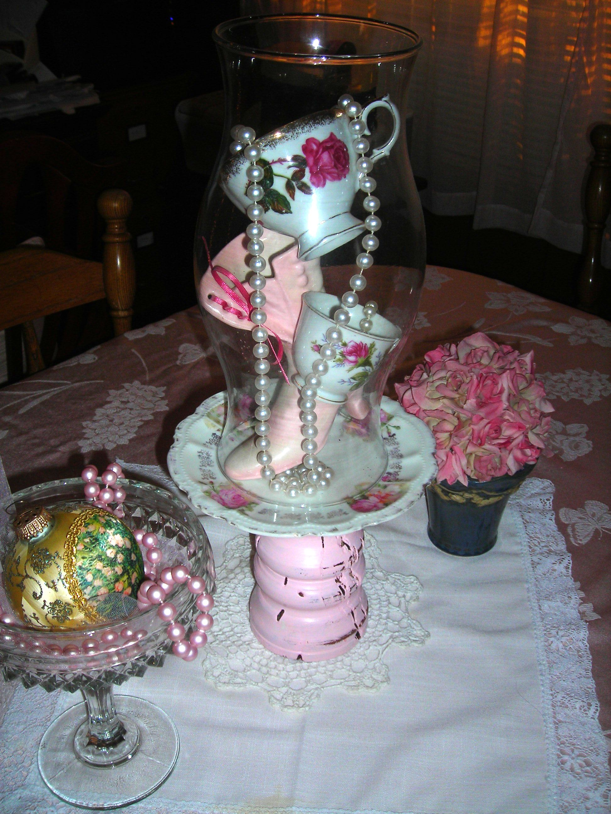 sweet vintage rose cups and pink victorian shoe inside glass shade ... thanks for the ideas, sue!