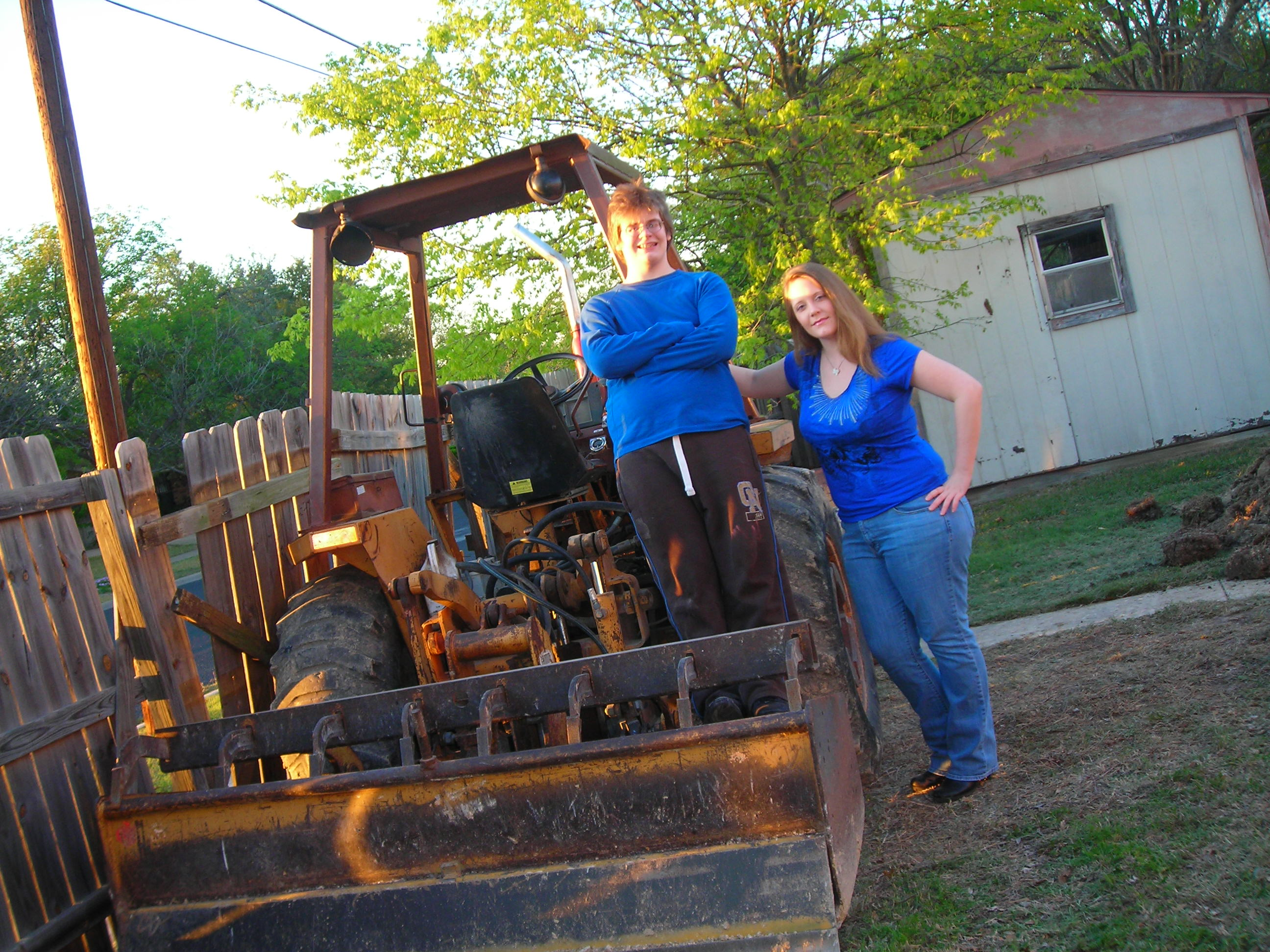 matt and tara horsing around on the heavy equipment ... when the crew's away, the mice will play!