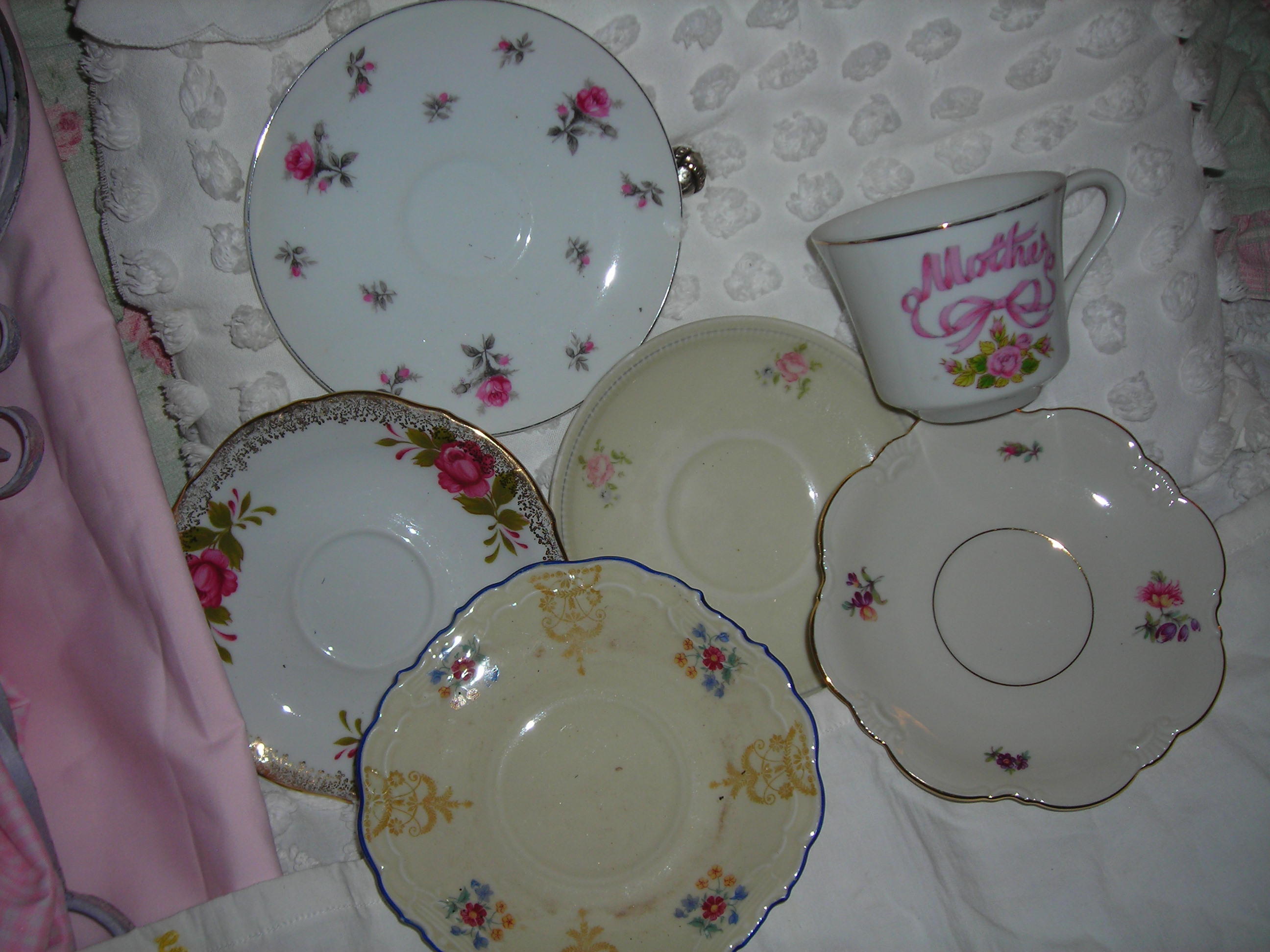 collection of little saucers and a sweet cup from cindy's sale