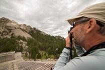 Dr. Tom in his tourist mode at Mount Rushmore. © Terry Ownby