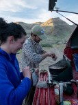 Alex and Nick cooking turkey chili at camp.