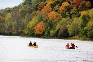 Colorful canoeists and fall colors on the St Croix