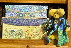 Peacock Bear next to peacock boxes