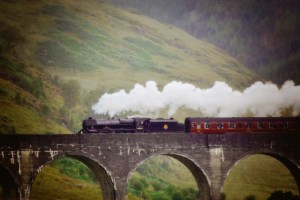 really close up of Harry Potter train over viaduct in rain misty (640x427)