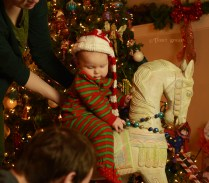 Baby in red and green on horse 1000 Christmas 473