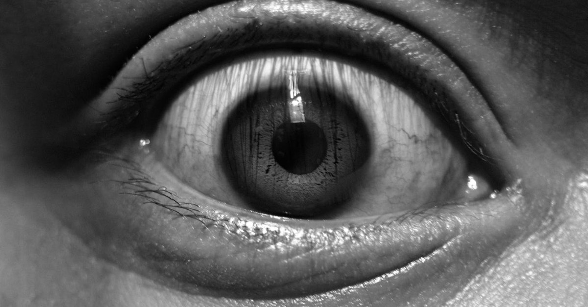Black and white close-up of a wide open eye
