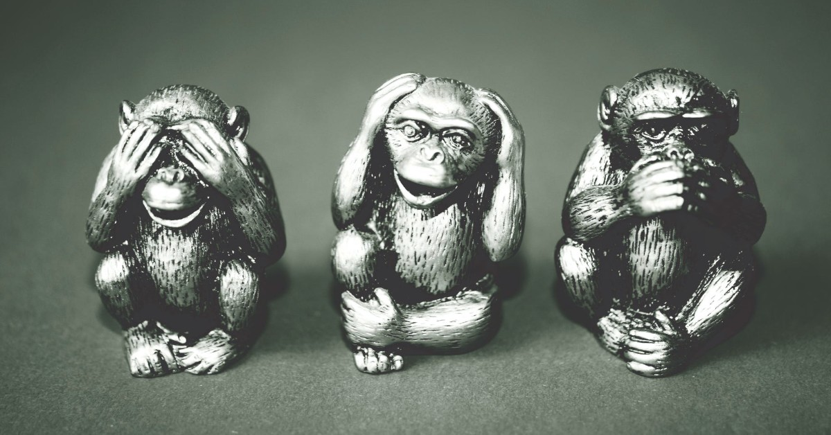 Black and white image of three wise monkeys
