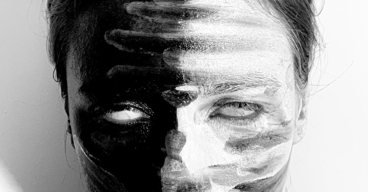 An abstract view of a woman's upper face in black and white