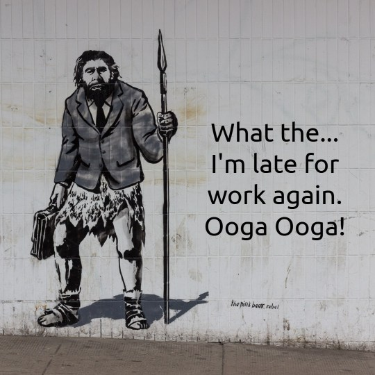 Graffiti on a wall showing a caveman wearing a coat and holding a spear and suitcase