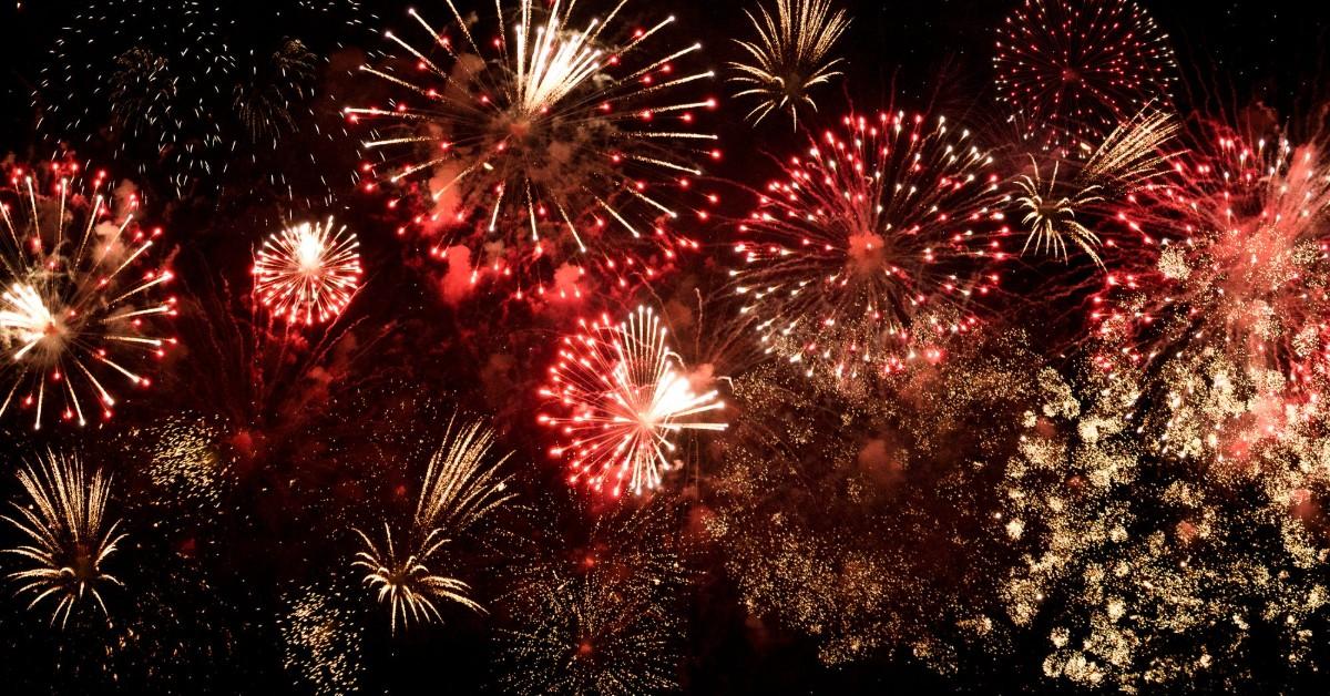 Fireworks display in the black night sky