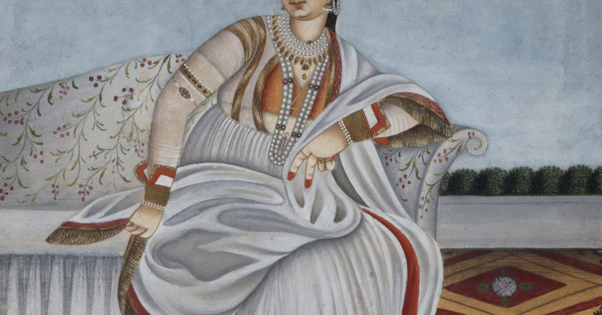 A painting of an Indian woman wearing a royal choli lehenga with jewelry