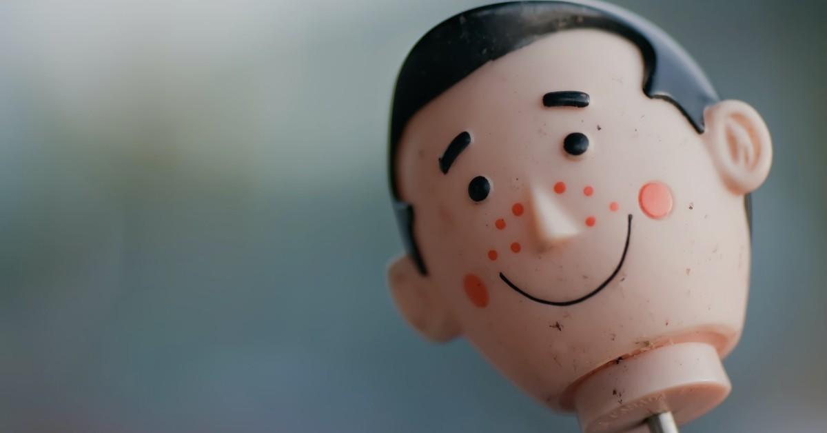 A pencil topper that is a plastic boy's head