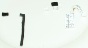 Plastics from the bottom side of the logic board