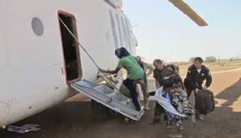 Photo released by UNMISS shows national from Uganda, Kenya, Eritrea and Ethiopia are evacuated by UN helicopter to Juba from Benitu