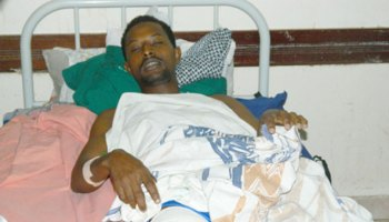 Abdi Mohammed, one of a number of Garissa residents who chased down a man suspected of being behind the recent killings of Ethiopian nationals, recovers from a gunshot wound at Garissa General Hospital on July 10th.