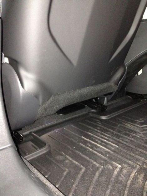 Rear seat mat under drivers seat