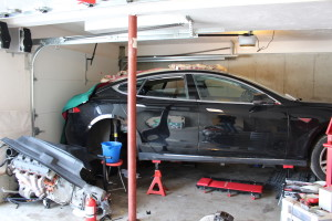 A tight fit and space to work on salvaging this Model S