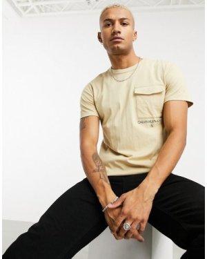 Calvin Klein Jeans institutional logo utility pocket t-shirt in beige