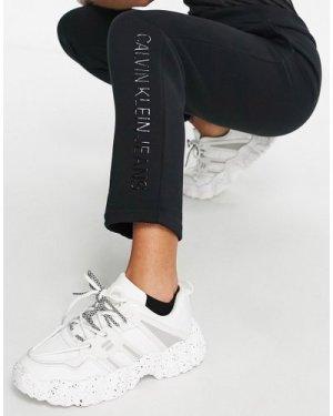 Calvin Klein Jeans shiny logo trousers in black