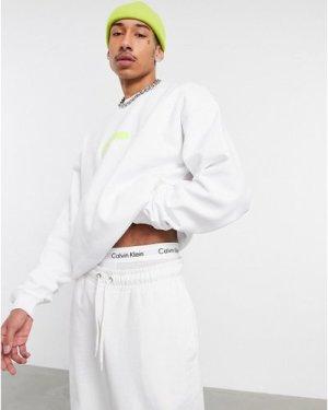 Calvin Klein Jeans neon bar monogram logo sweatshirt in white