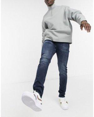 Calvin Klein Jeans slim tapered jeans in blue black wash