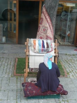 On our cruise we docked at Istanbull and did a bus tour of the city. When we stopped at the lights, here was a Turkish woman weaving on the street right in the middle of people coming and going.
