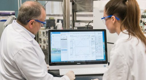 Student and professor working together in laboratory