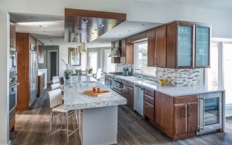 """Kitchen and bar area. Breakfast nook is beyond. The island top is 4"""" thick."""