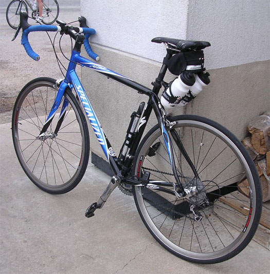 My bike with its new rear tire in Johnson City.  Still with torn bar tape, and with one silver and one white bar plug.