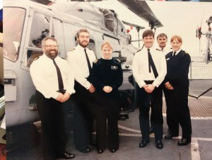 (Center) On the helo deck of H.M.S. Sheffield with colleagues, deployed as US liaison to the Royal Navy in the summer of 1994. It was customary that the US liaison officer wear Royal Navy rank insignia.