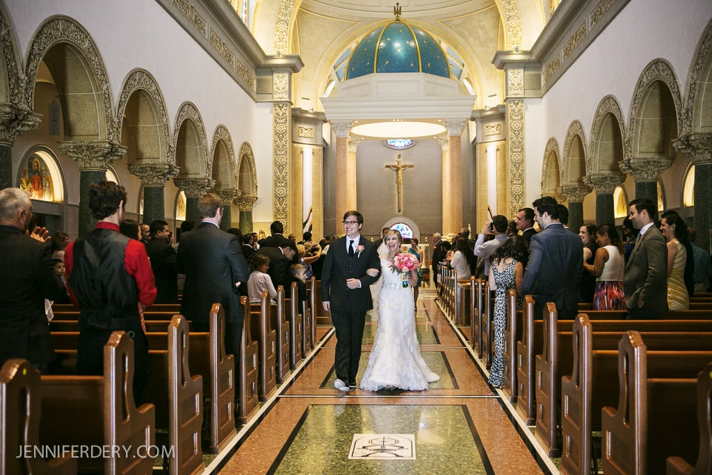 photo of bride and groom leaving the church - recessional - Immaculata USD