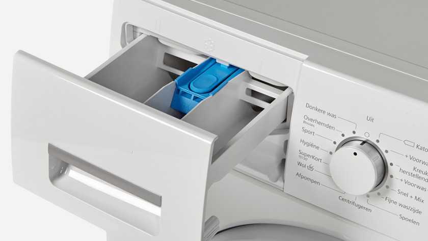 Wasmachine wasbakje poeder vloeibaar