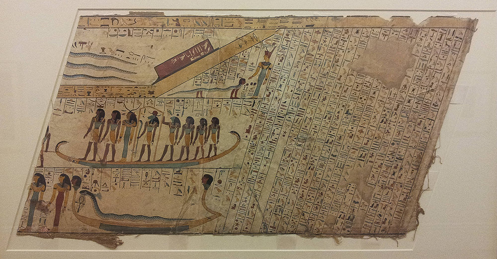 Depiction of the underworld, with gods standing in large boats and hieroglyphs in diagonal columns