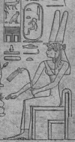 A closeup of part of a carved stela showing Tetisheri seated, holding a flail, with some hieroglyphs beside her