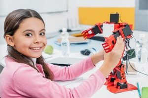 Girl building robot