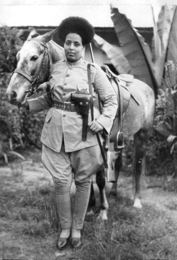 Ethiopian female soldier preparing to fight against Benito Mussolini's fascist Italy in 1935