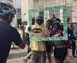 "Supporters set up a selfie frame that says ""Pass the Bike Plan"""