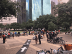 City Hall plaza with people, bicycles, and a temporary bike lane rolled out across the plaza.