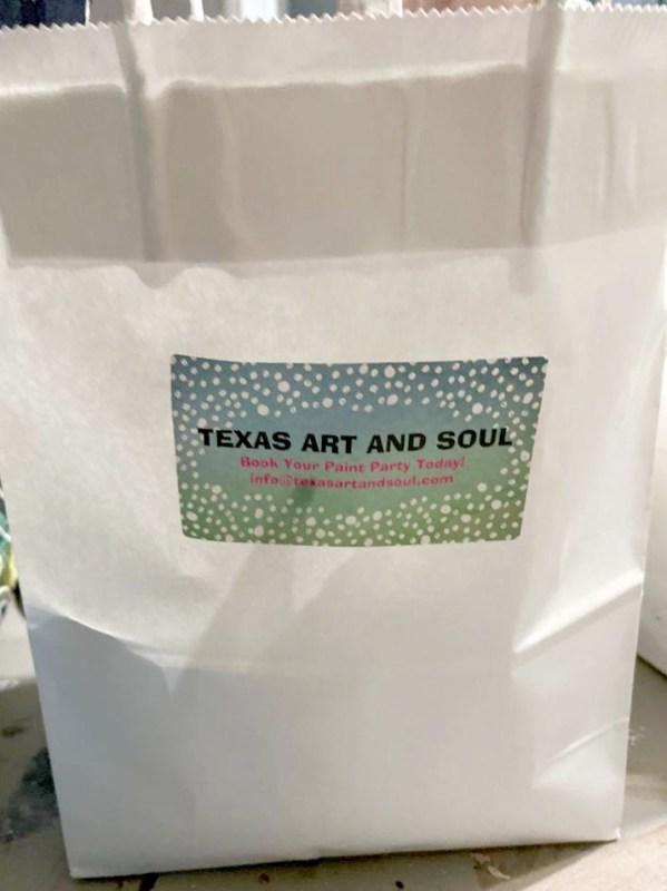 white gift bag with Texas Art and Soul sticker - paint party online goodie bag