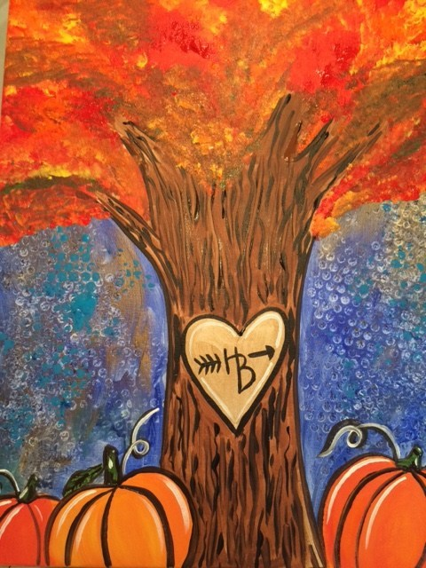 fall art project with a tree and pumpkins