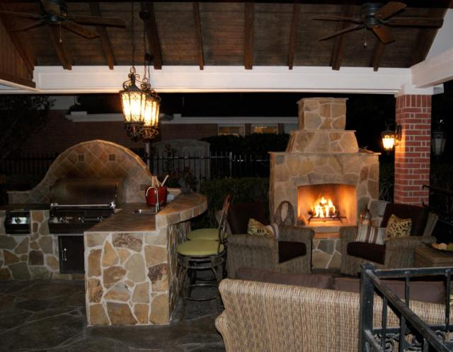 gable roof patio cover with outdoor kitchen & fireplace - texas