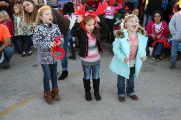 Three young girl cheering to wake up Santa Claus.