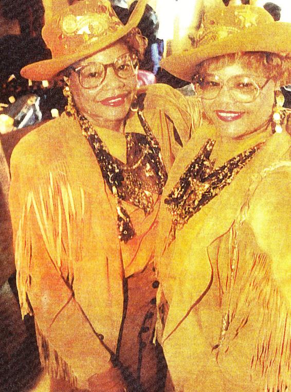 Twins in gold, fringe attire